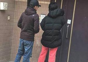 王菲谢霆锋牵手溜街像老夫老妻 谢霆锋原来这么高!